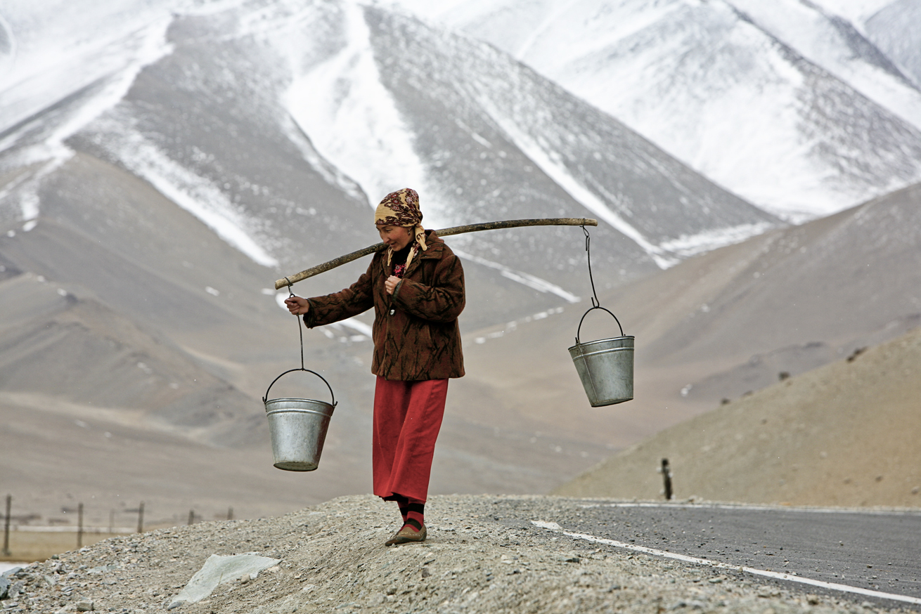 Uigher Woman Carrying Water