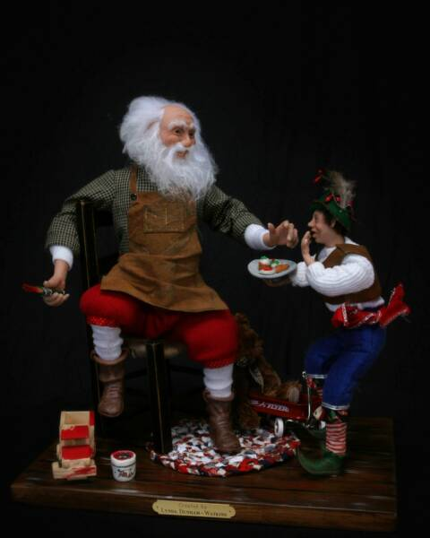 Santa & Helper Elrod. Hand carved clay and hand-sewn garments.