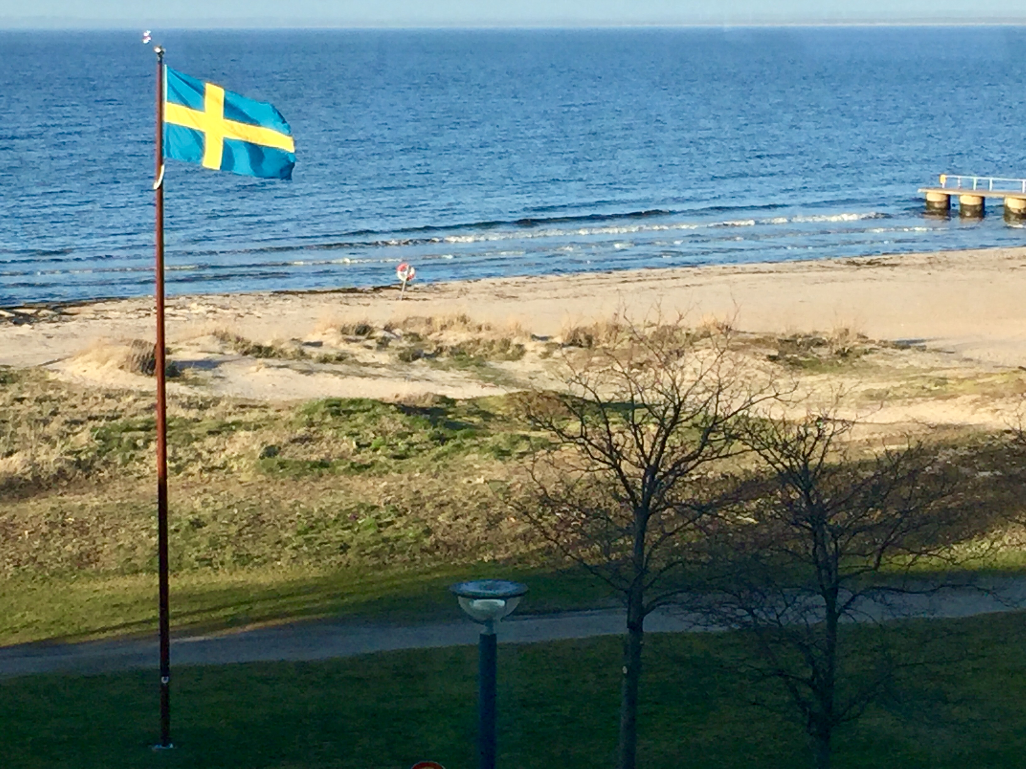 Swedish flag flying over coast of North Sea