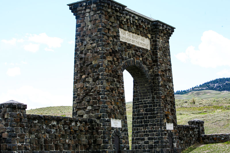 the large stone entrance to Yellowstone in Gardner, Montana